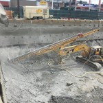 Soil Nail shafts in dense soils w/ full length pipe & down-hole hammer
