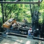 Anchor installation from crane held platform