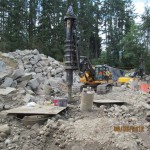 Installing drilled shafts utilizing multiple temp. casing through boulders and cobbles