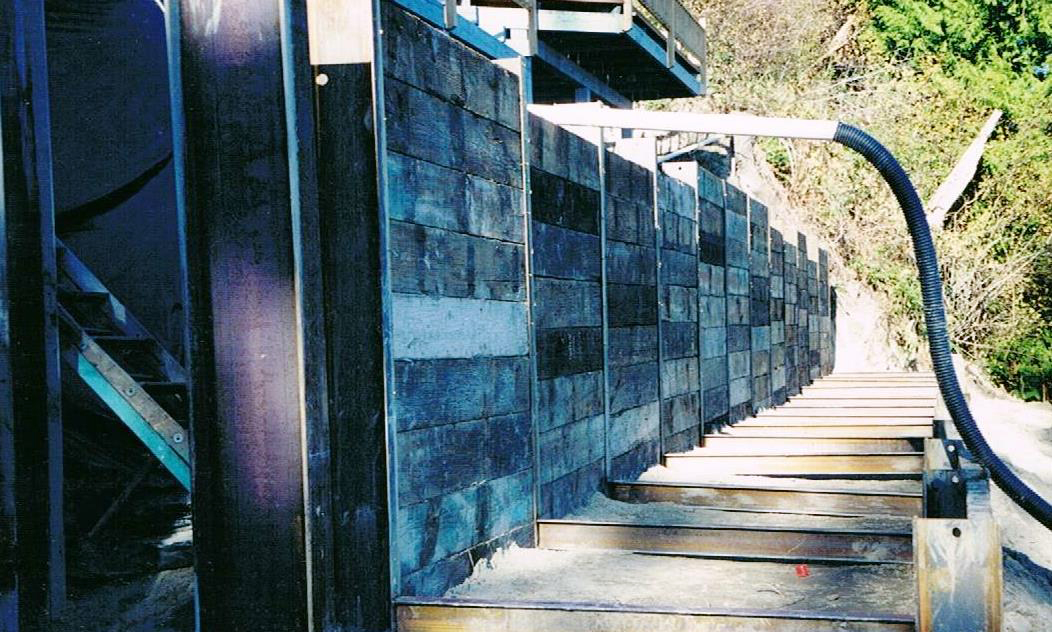"""http://www.dmidrilling.com/wp-content/uploads/2017/10/res-""""chair""""-design-soldier-beam-retaining-wall-complete.jpg"""